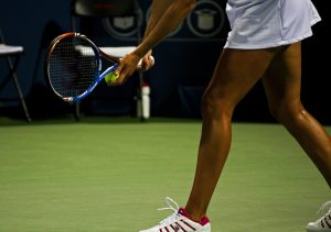 Tennis female player getting ready to serve